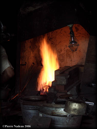 Japanese swordsmith's charcoal forge on fire